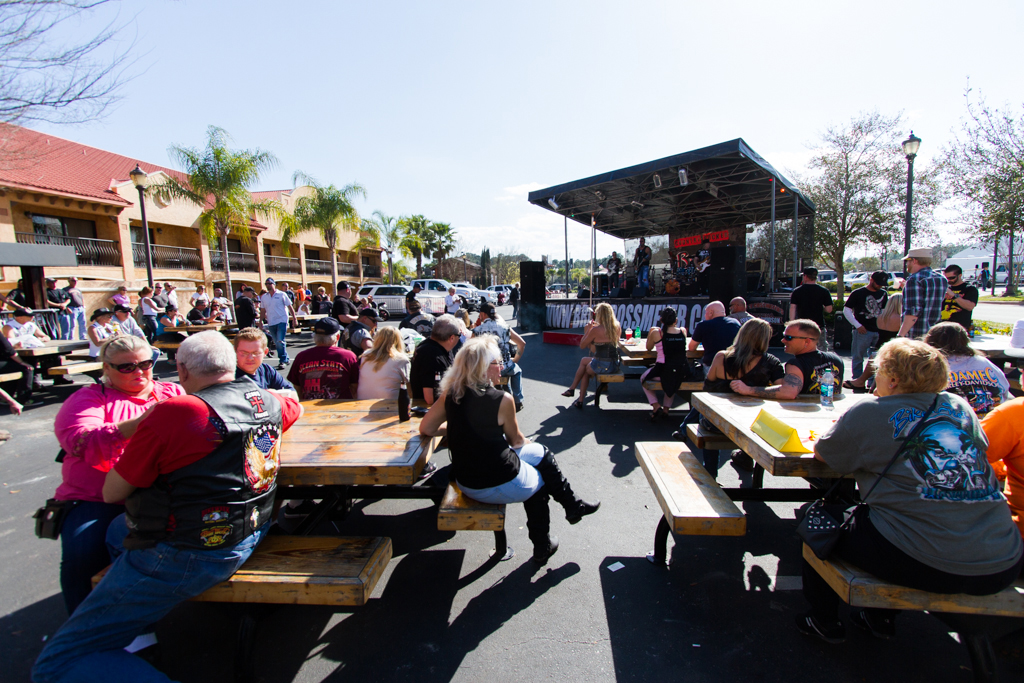 Attendees watch a band perform at Bruce Rossmeyer's Destination Daytona during the 73rd annual Bike Week on Saturday, March 15.