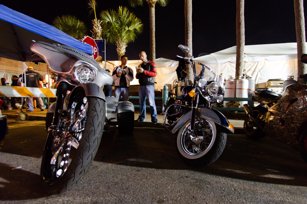 Two men eat while by parked motorcycles during the 73rd annual Bike Week in Daytona Beach on Friday, March 14.