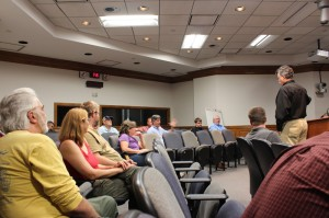 Walter McCown (far right) answers a man's question about the black bear's natural range in Florida during the public meeting for the bear stakeholder group. This was one of many topics discussed at the last of seven meetings held in the central Florida region.