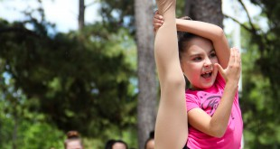 A younger member of the O2B Kids Fusion Dance Companyshows off her flexibility during a dance routine at the 3rd annual Duck Derby on Sunday afternoon.
