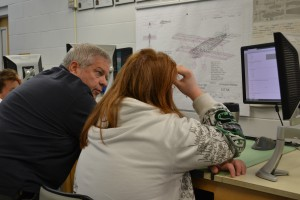E.H. Lindsey works with a student using Autodesk software.