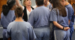 The women's House of Hope director Jennifer Smith prays with the inmates at the Lowell Correctional Institution in Marion County during chapel on November 6, 2012.