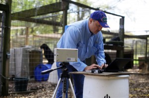 Karl Zawoy, the cheif technology investigator at TruVitals, prepares the vital signs monitor for testing wild cats at an animal sanctuary in Florida on March 20, 2014. For reasons pertaining to the contract, the name and location of the sanctuary cannot be named.