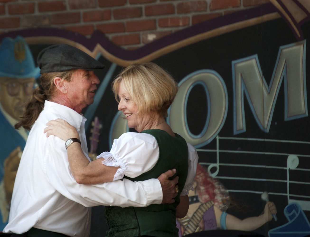 Michael Croft and Sabine Lanninger partner dance as part of the Irish set dancing performances by the Gainesville's Inisheer Irish Dance Company at Bo Diddley Community Plaza Sunday.