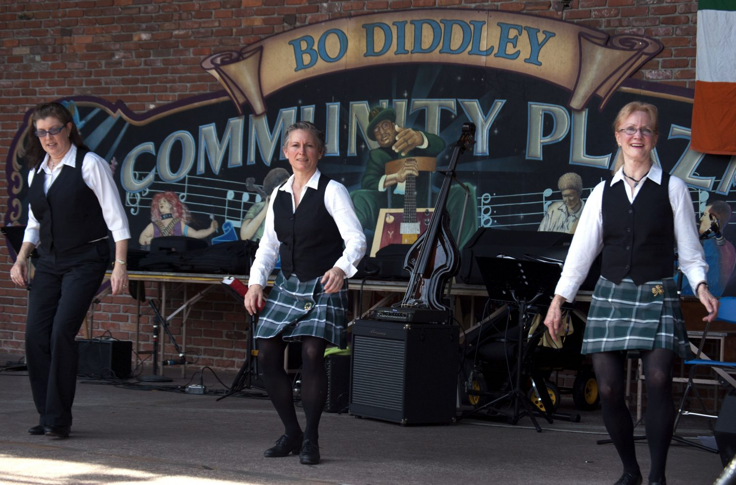 (Left to right) Virginia Boone, Piper Call and Rusty Forsmark perform Irish set dancing at the Viva Europe Festival at Bo Diddley Community Plaza Sunday.