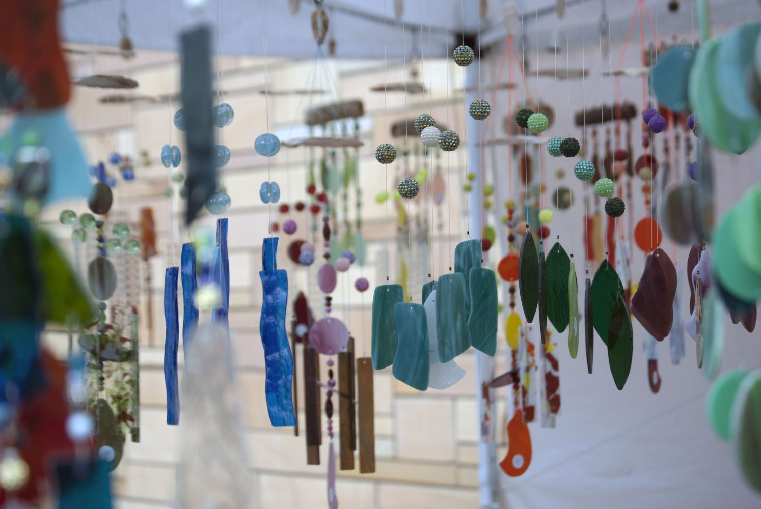 Jeff Kline, of Stuart, Fla., filled one of the first tents with his handcrafted stained-glass wind chimes at the Santa Fe College Springs Arts Festival Sunday.