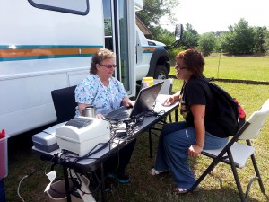 Staff member Linda Wall asks Bobellina Moric, a homeless veteran, about her medical history on April 7, 2014. Moric visited the bus to get a physical since it is difficult to reach health care services in Hernando, Fla.
