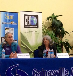 Helen Warren (left) debates issues facing the Gainesville community with commission-opponent Annie Orlando (right) at a forum on Thursday.