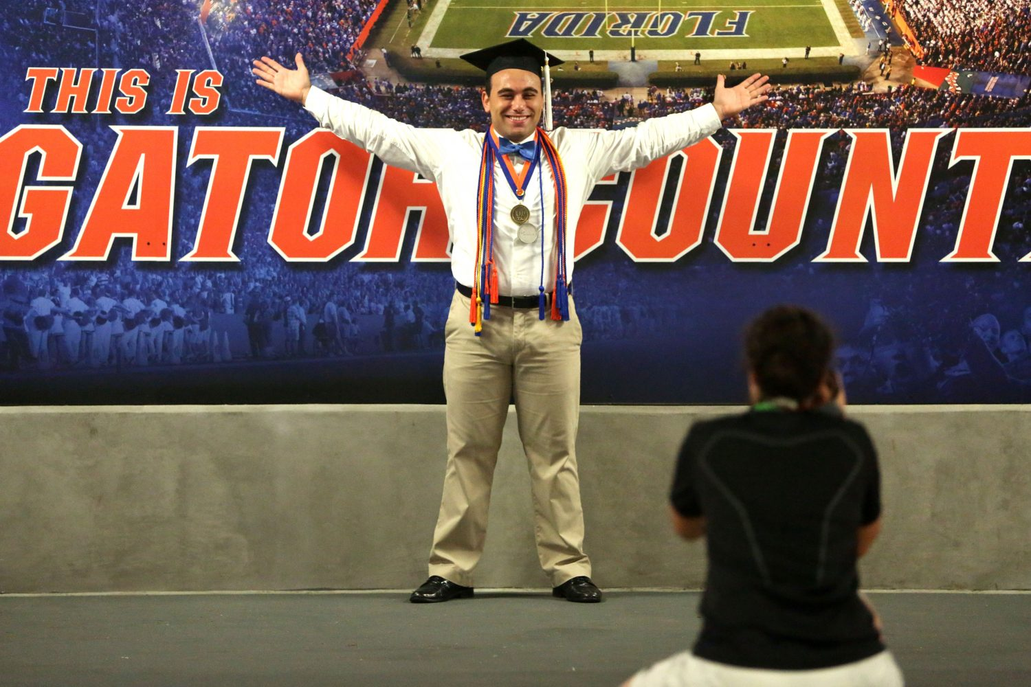 Greg Cohen, 22, poses for photographer Katie Sastre, 20, for his graduation shoot at Ben Hill Griffin Stadium at the University of Florida on Thursday, May 1, 2014, in Gainesville, Fla. Cohen will graduate with a B.A. in economics.