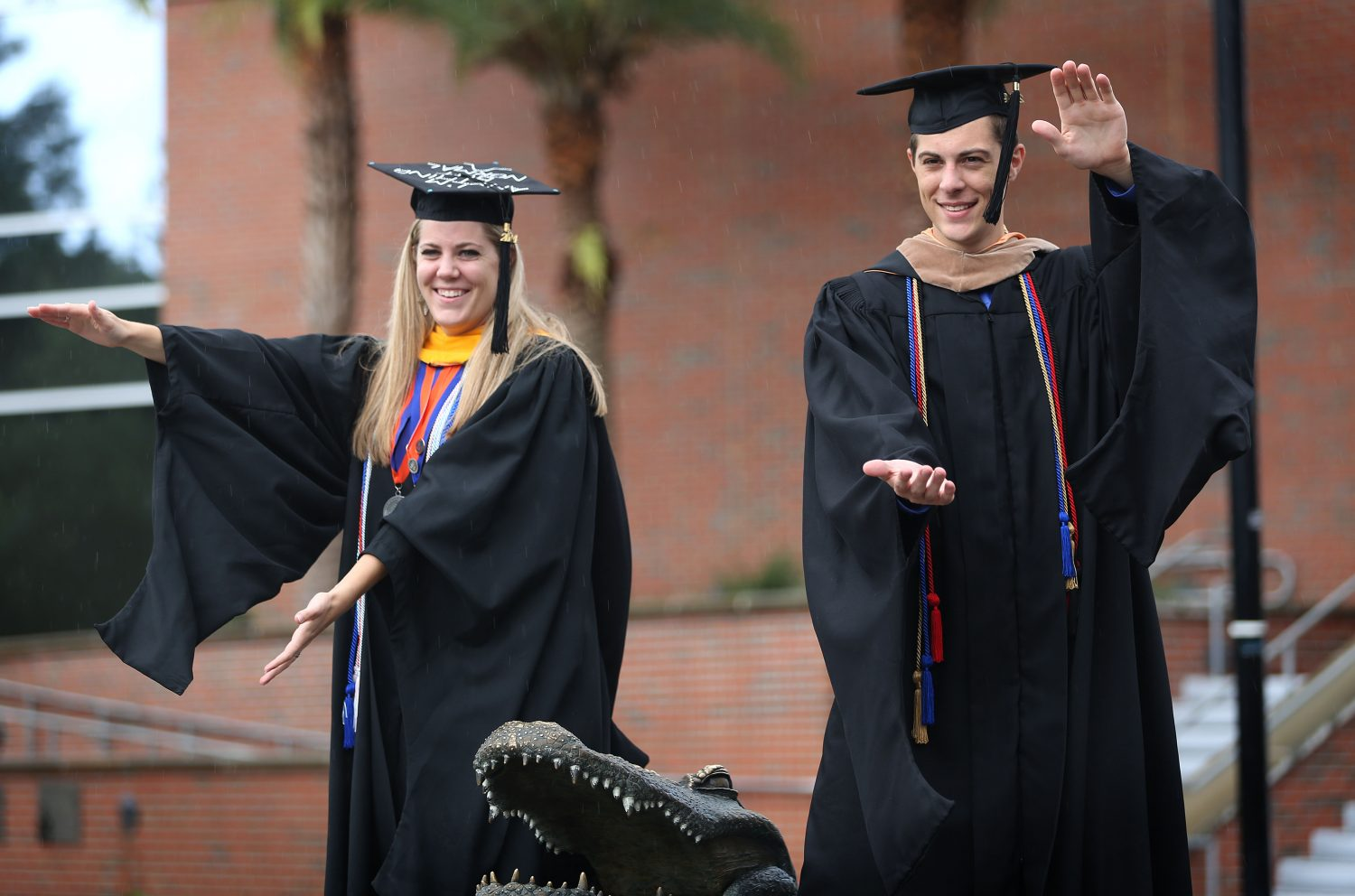 Kirsten Soucek, 22, and her twin brother Alex Soucek, 22, pose for a photo during their graduation shoot at Ben Hill Griffin Stadium at the University of Florida on Thursday, May 1, 2014, in Gainesville, Fla. Kirsten will graduate with a masters in statistics and Alex will graduate with a masters in accounting.