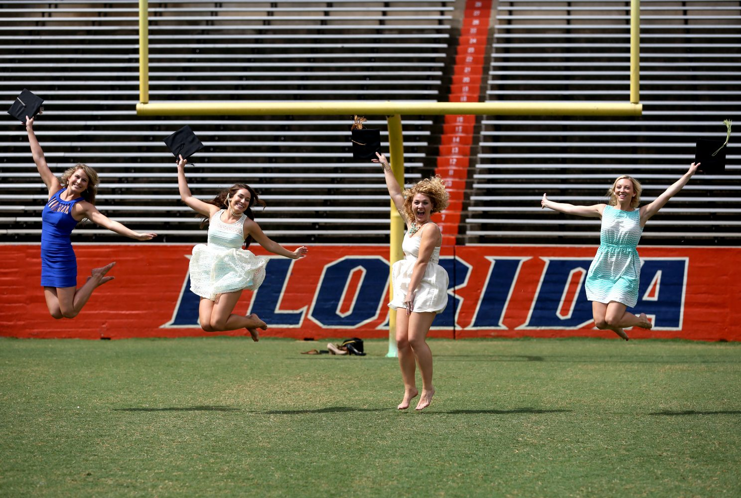 Graduates pose for a photo during their graduation shoot at Ben Hill Griffin Stadium at the University of Florida on Thursday, May 1, 2014, in Gainesville Fla.