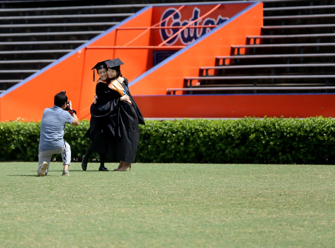UF graduates pose for photos at Ben Hill Griffin Stadium on May 1, 2014, in Gainesville, Fla.