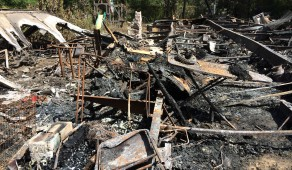 The charred remains of a Levy County home are all that remain following a fire that killed two people early Wednesday morning, August 20, 2014. (Virginia Hamrick/WUFT News)