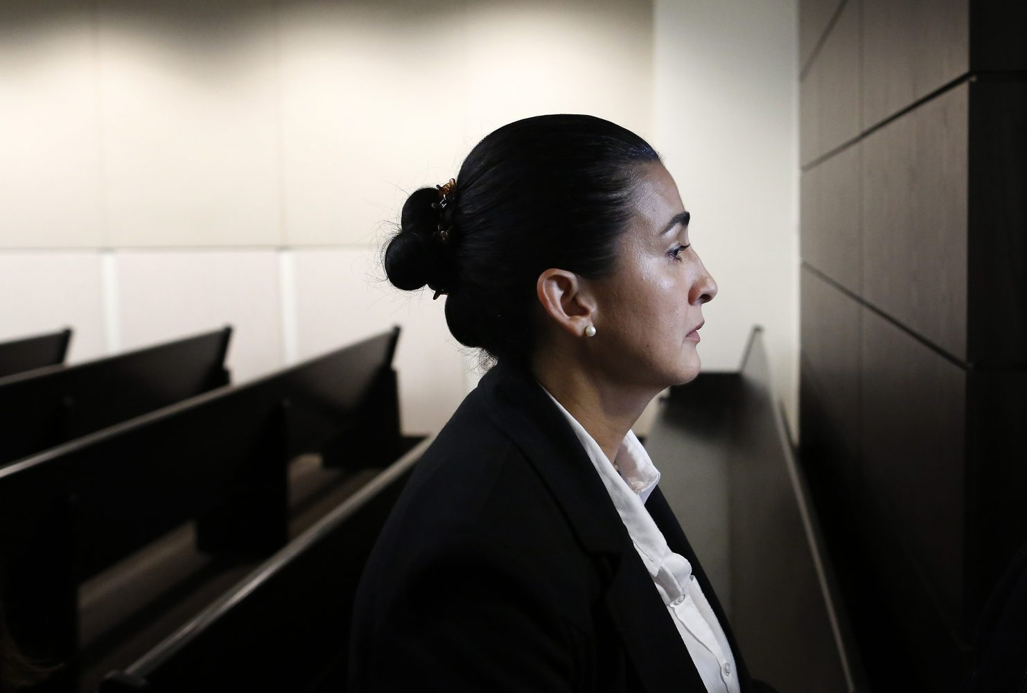 Claudia Aguilar, the mother of Christian Aguilar, leaves the courtroom following the prosecution's opening statements in the case against Pedro Bravo in courtroom 1B of the Alachua County Criminal Justice Center Tuesday, August 5, 2014.  Bravo is accused of murdering her son.  (Doug Finger/The Gainesville Sun/Pool)