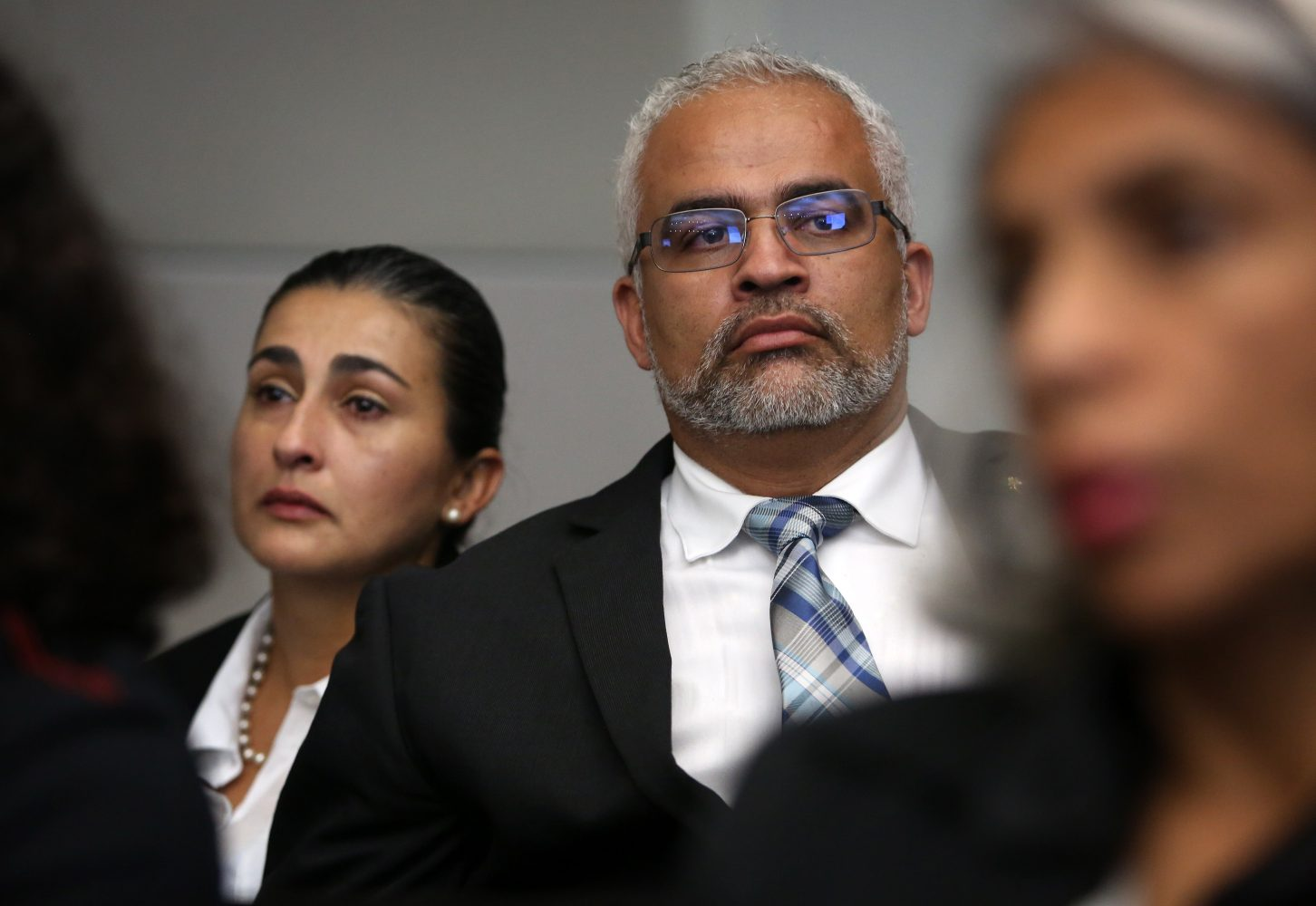Carlos and Claudia Aguilar listen as the prosecution gives opening statements in the case against Pedro Bravo in courtroom 1B of the Alachua County Criminal Justice Center Tuesday, August 5, 2014.  Bravo is accused of murdering their son.  (Doug Finger/The Gainesville Sun/Pool)