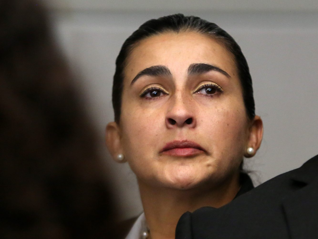 Claudia Aguilar listens as the prosecution gives opening statements in the case against Pedro Bravo in courtroom 1B of the Alachua County Criminal Justice Center Tuesday, August 5, 2014.  Bravo is accused of murdering her son.  (Doug Finger/The Gainesville Sun/Pool)