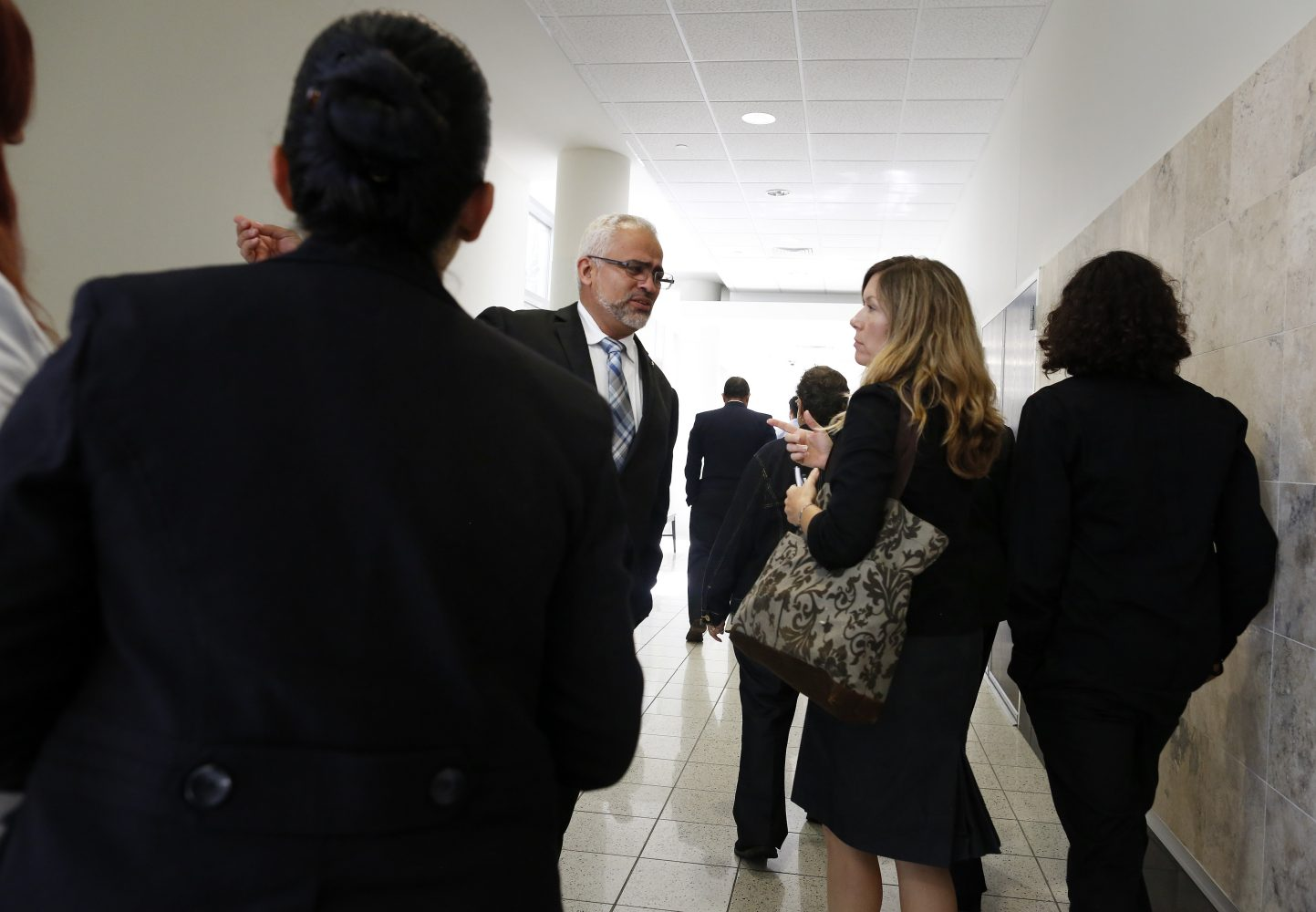 Carlos Aguilar, the father of Christian Aguilar, leaves the courtroom for a lunch recess following the prosecution's  opening statements in the case against Pedro Bravo in courtroom 1B of the Alachua County Criminal Justice Center Tuesday, August 5, 2014.  (Doug Finger/The Gainesville Sun/Pool)