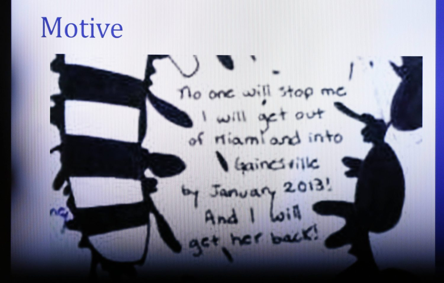 The prosecution shows a photo of writings found in a book allegedly written by Pedro Bravo during opening statements in the murder case against Bravo in courtroom 1B of the Alachua County Criminal Justice Center Tuesday, August 5, 2014.  (Doug Finger/The Gainesville Sun/Pool)