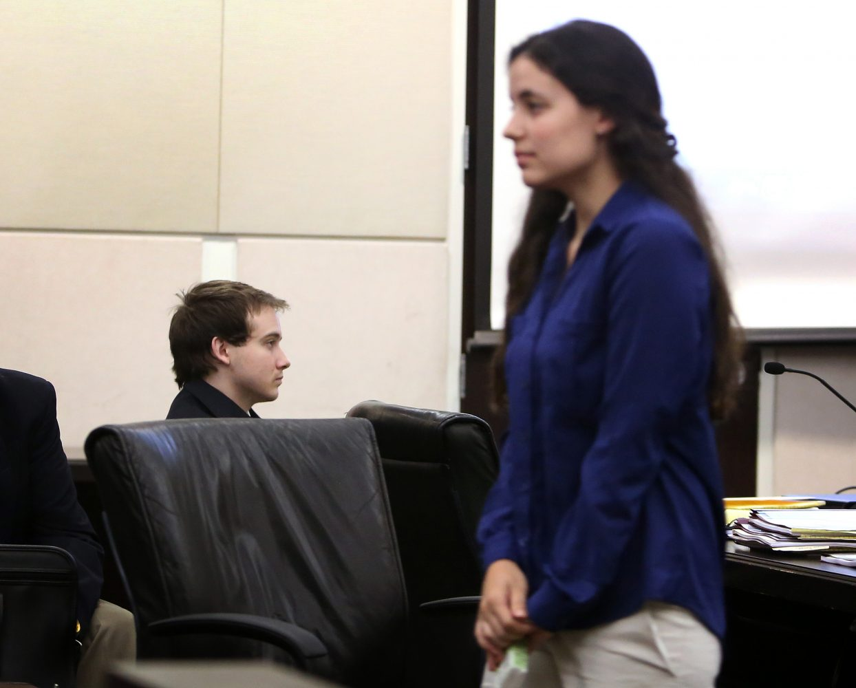 Erika Friman, the former girlfriend of Pedro Bravo, at left, leaves courtroom 1B of the Alachua County Criminal Justice Center for the day following her testimony Tuesday, August 5, 2014.  Bravo is accused of killing his friend and Friman's new boyfriend Christian Aguilar.  (Doug Finger/The Gainesville Sun/Pool)