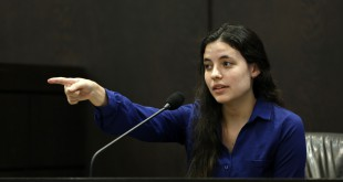Erika Friman, the girlfriend of slain University of Florida student Christian Aguilar, points out former boyfriend and murder defendant Pedro Bravo while on the stand during Bravo's trial in courtroom 1B of the Alachua County Criminal Justice Center Tuesday, August 5, 2014.  Bravo is accused of killing Aguilar.  (Doug Finger/The Gainesville Sun/Pool)