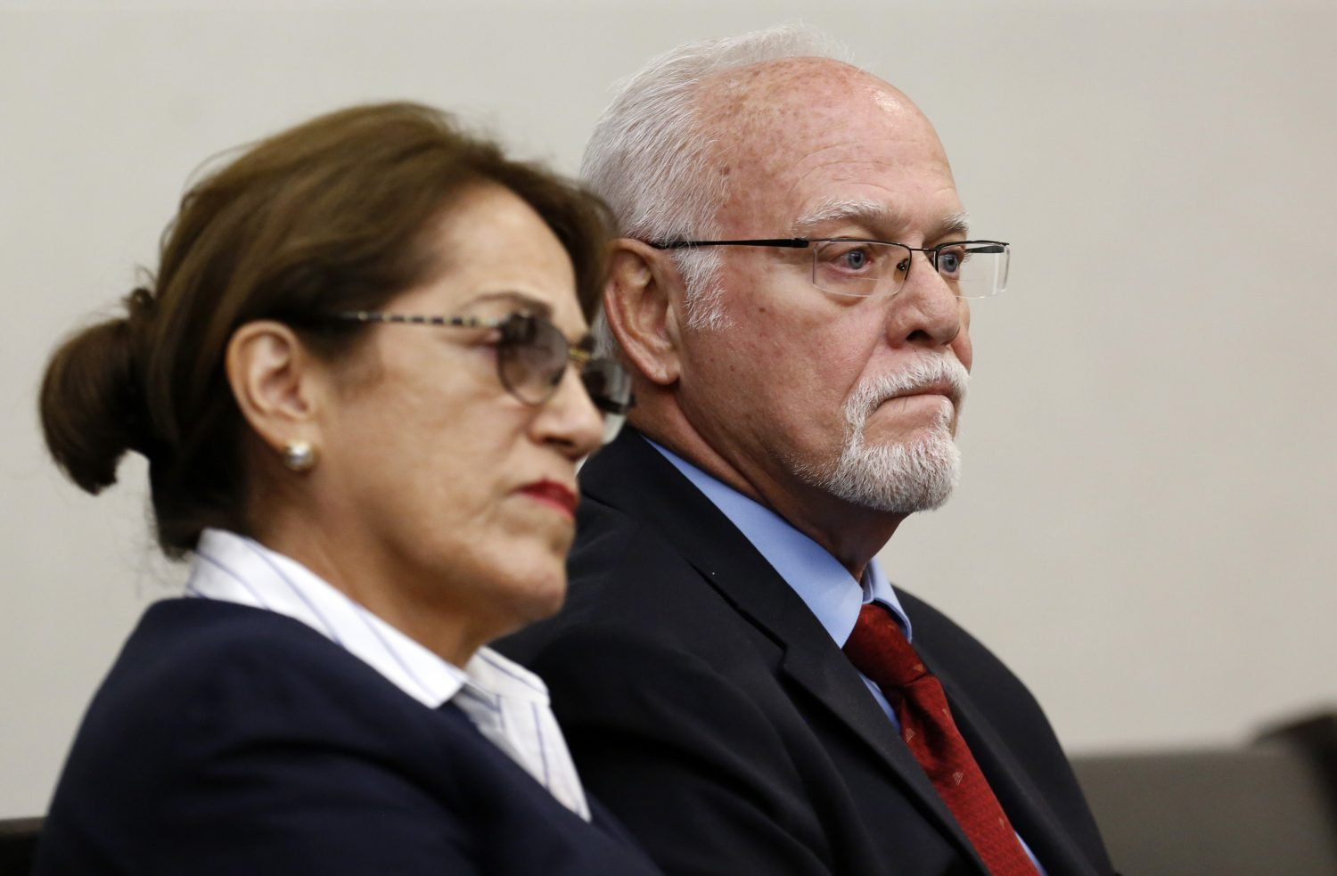 The parents of defendant Pedro Bravo listen to the prosecution give opening statements during their son's murder trial in courtroom 1B of the Alachua County Criminal Justice Center Tuesday, August 5, 2014.  Pedro is accused of killing friend and University of Florida student Christian Aguilar.  (Doug Finger/The Gainesville Sun/Pool)