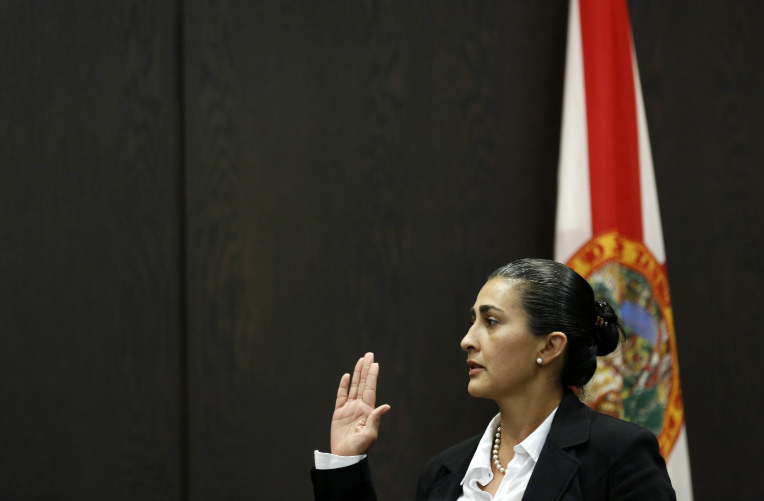 Claudia Aguilar, the mother of slain University of Florida student Christian Aguilar, is sworn in before testifying in the murder trial of Pedro Bravo in courtroom 1B of the Alachua County Criminal Justice Center Tuesday, August 5, 2014.  (Doug Finger/The Gainesville Sun/Pool)