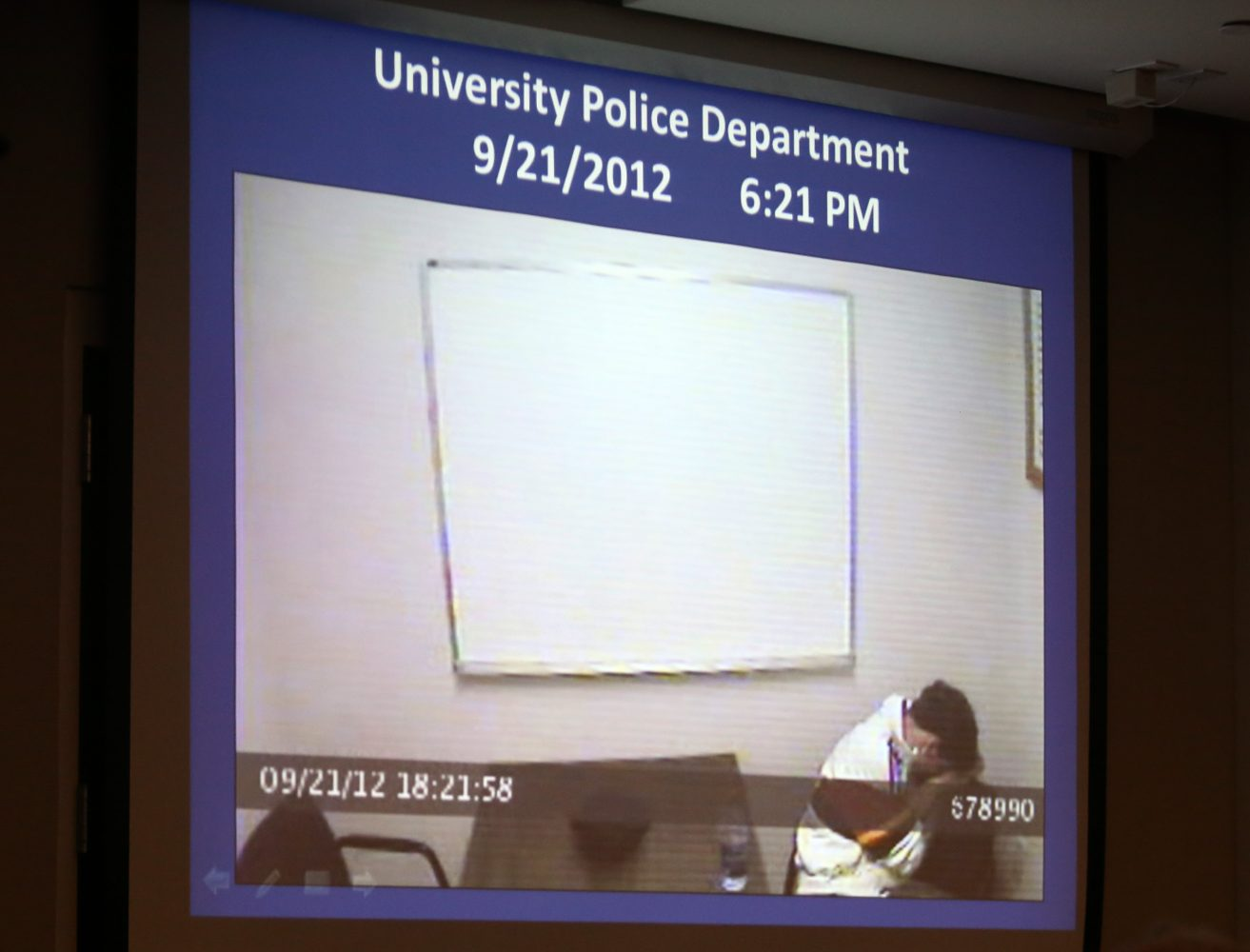 The prosecution shows a screen-grab from a camera of Pedro Bravo's police interview a day after Christian Aguilar went missing during Bravo's murder trial in courtroom 1B of the Alachua County Criminal Justice Center Tuesday, August 5, 2014.  (Doug Finger/The Gainesville Sun/Pool)