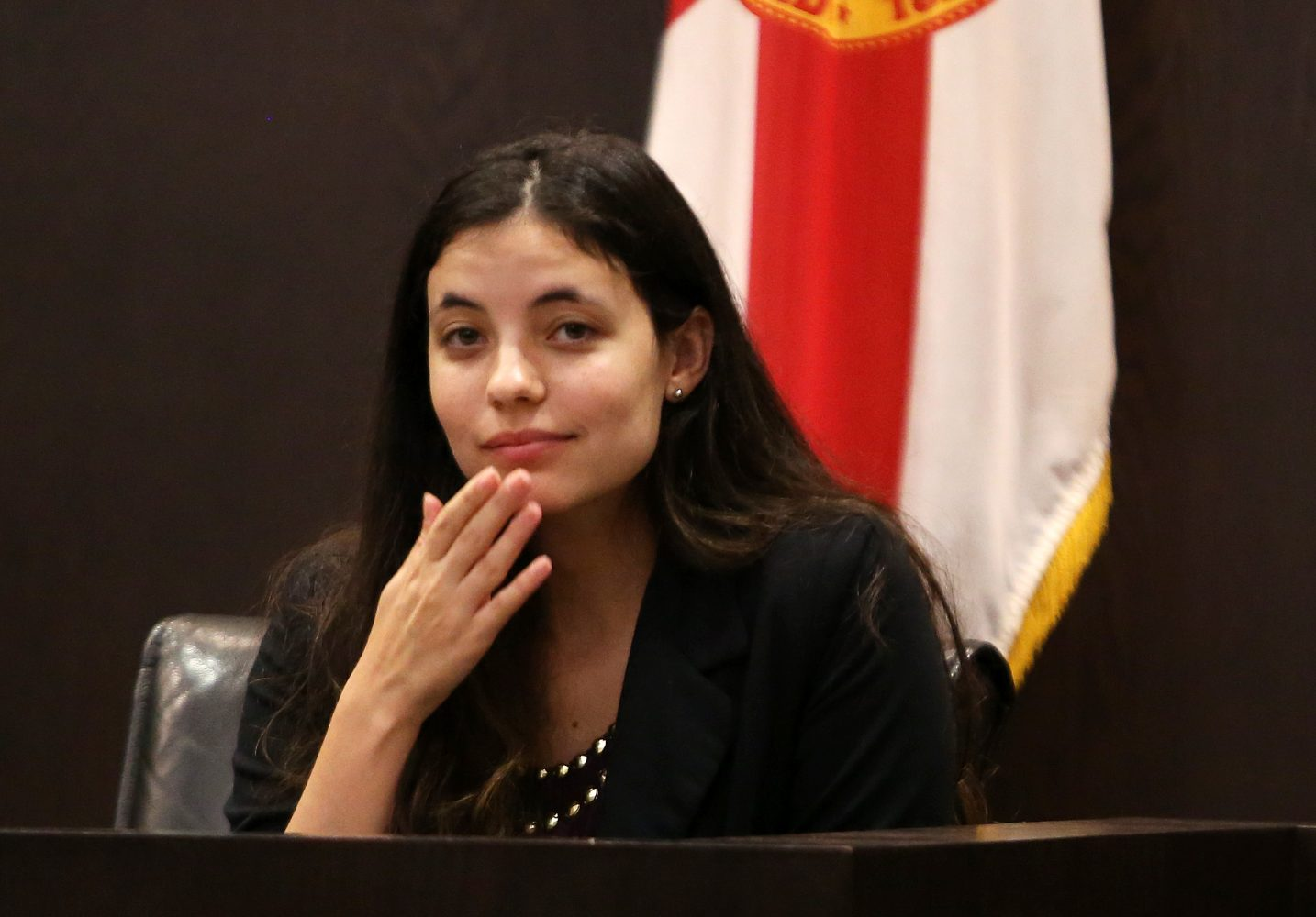 Erika Friman, the girlfriend of victim Christian Aguilar, blows a kiss to the Aguilar family during a pause in her testimony during the murder trial of Pedro Bravo in courtroom 1B of the Alachua County Criminal Justice Center Wednesday, August 6, 2014.  (Doug Finger/The Gainesville Sun/Pool)