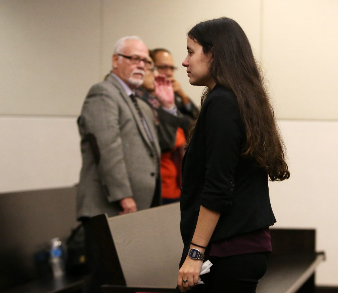 Erika Friman, the girlfriend of victim Christian Aguilar, breaks from her testimony after becoming emotional  during the murder trial of Pedro Bravo in courtroom 1B of the Alachua County Criminal Justice Center Wednesday, August 6, 2014.  At back are Bravo's parents.  (Doug Finger/The Gainesville Sun/Pool)
