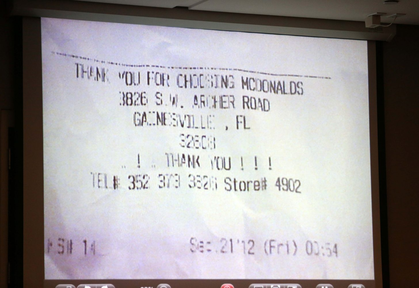 A receipt from a local McDonald's that Pedro Bravo went to early Friday morning on September 21, 2012 during the disappearance of friend Christian Aguilar is shown during Bravo's murder trial in courtroom 1B of the Alachua County Criminal Justice Center Wednesday, August 6, 2014.  Bravo is accused of killing the University of Florida student.  (Doug Finger/The Gainesville Sun/Pool)