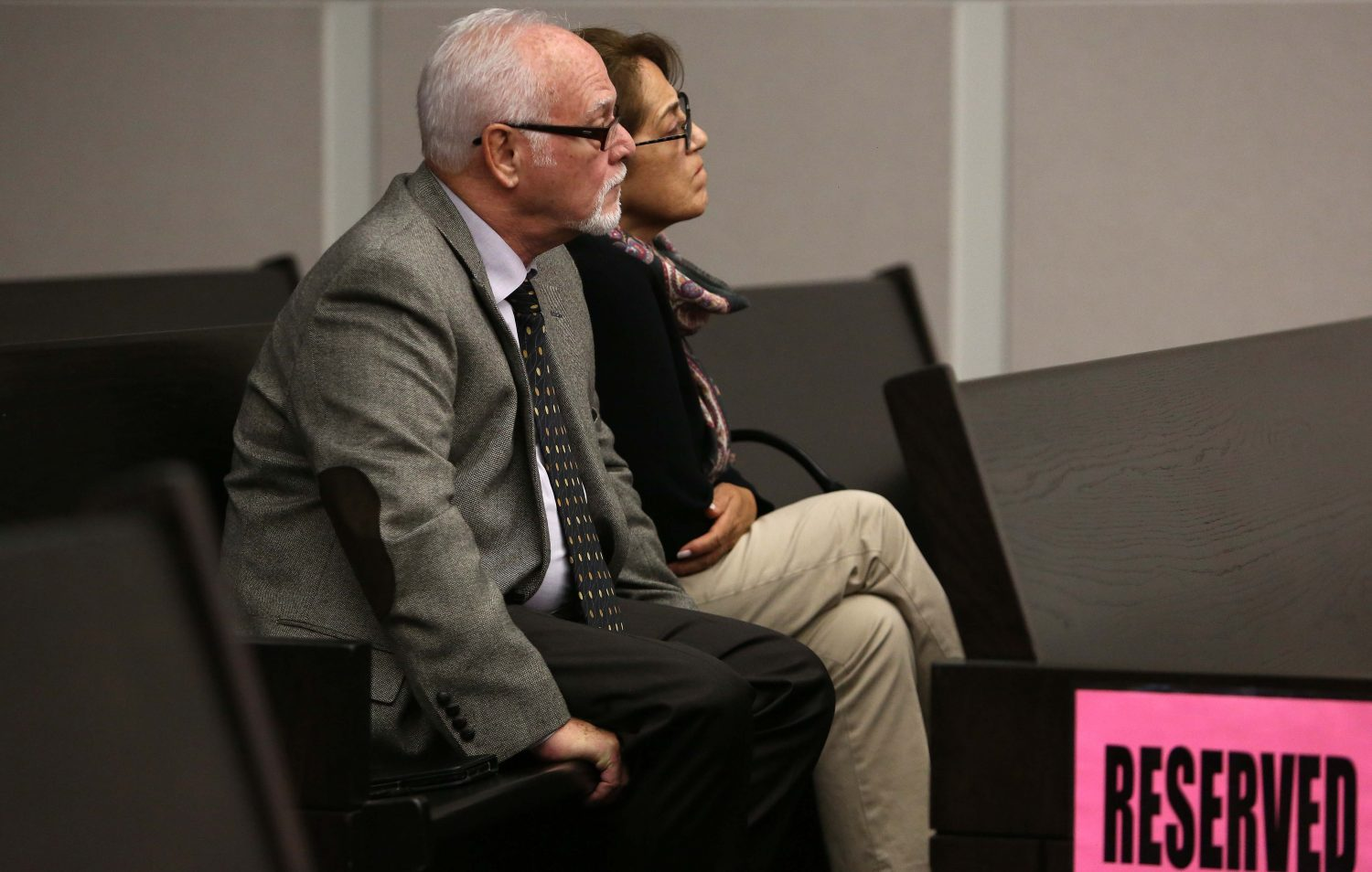 The parents of Pedro Bravo look at evidence photos at their son's murder trial in courtroom 1B of the Alachua County Criminal Justice Center Wednesday, August 6, 2014.  Bravo is accused of killing University of Florida student Christian Aguilar.  (Doug Finger/The Gainesville Sun/Pool)