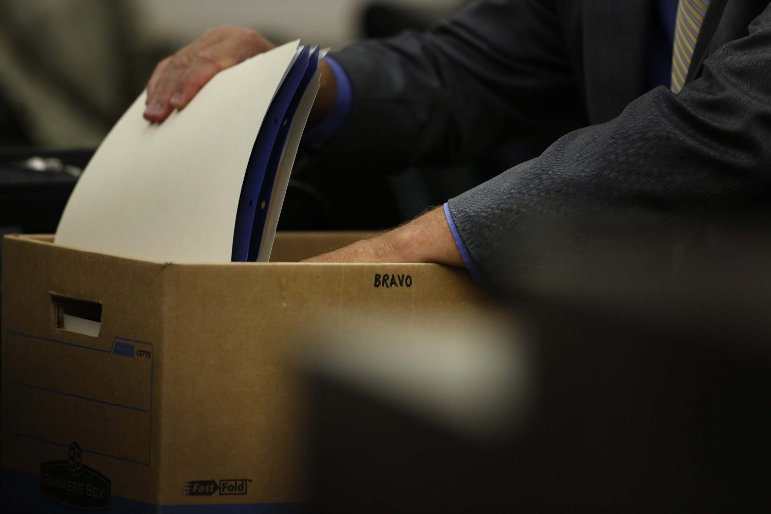 Pedro Bravo's defense attorney Michael Ruppert removes a folder from a box marked Bravo during day 3 of Bravo's murder trial in courtroom 1B of the Alachua County Criminal Justice Center Thursday, August 7, 2014.  Bravo is accused of killing University of Florida student Christian Aguilar.  (Doug Finger/The Gainesville Sun/Pool)