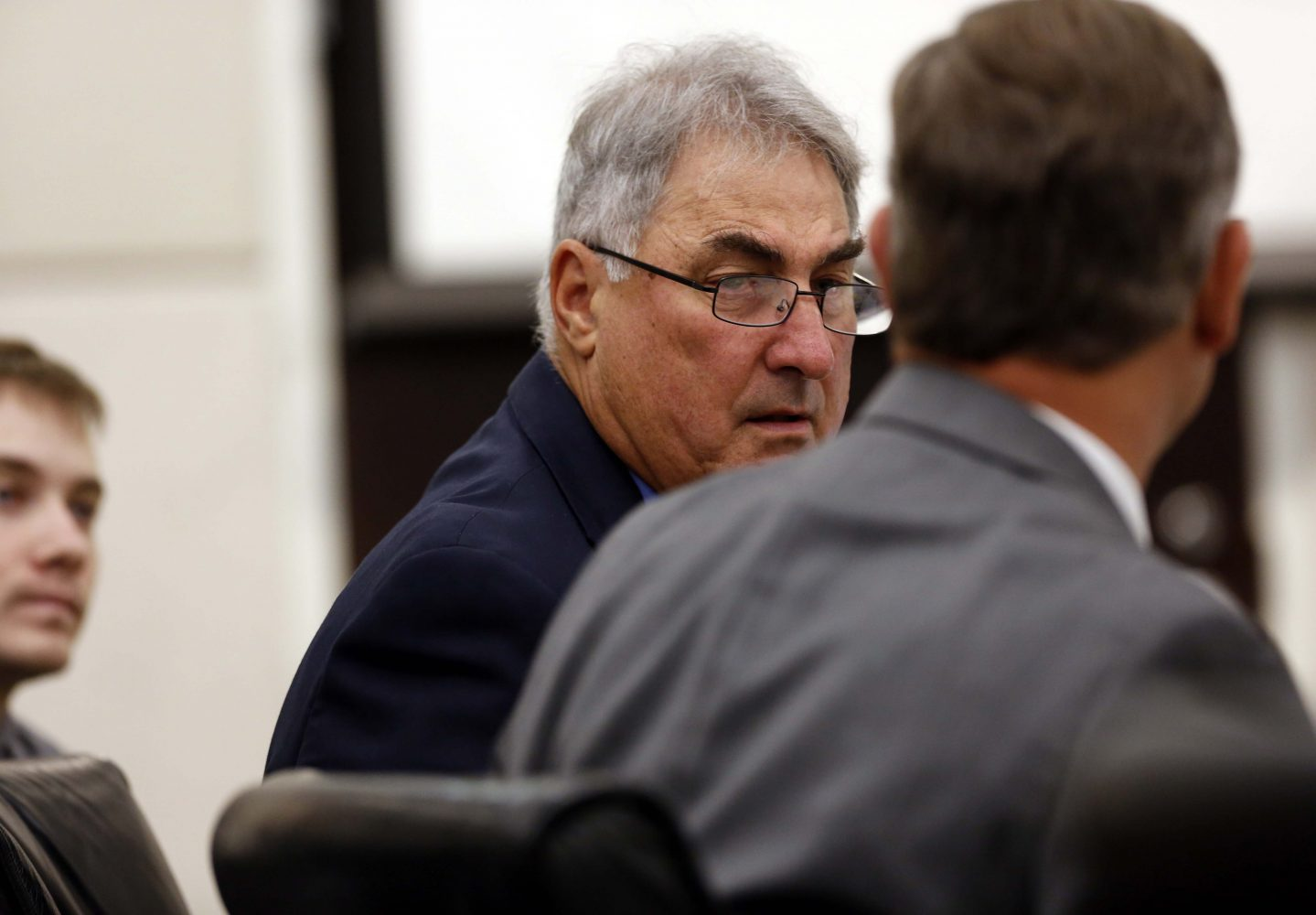 Defense attorneys Stephen Bernstein, facing, and Michael Ruppert talk during defendant Pedro Bravo's murder trial in courtroom 1B of the Alachua County Criminal Justice Center Friday, August 8, 2014.  Bravo is accused of killing University of Florida student Christian Aguilar.  (Doug Finger/The Gainesville Sun/Pool)