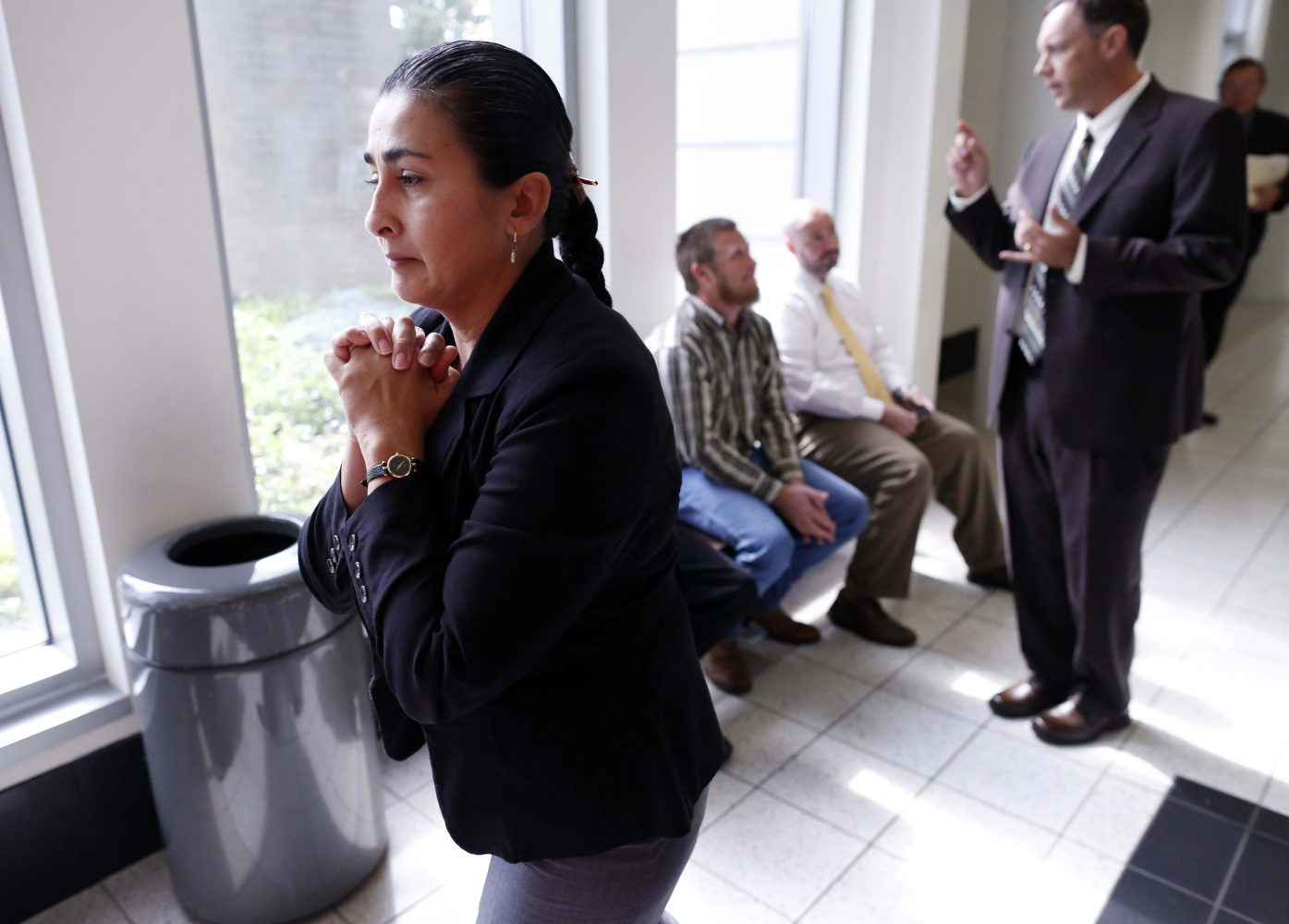 Claudia Aguilar, the mother of slain University of Florida student Christian Aguilar, walks the hall outside of courtroom 1B of the Alachua County Criminal Justice Center during a mid-morning recess for Pedro Bravo's murder trial Friday, August 8, 2014.  Bravo is accused of killing University of Florida student Christian Aguilar.  (Doug Finger/The Gainesville Sun/Pool)