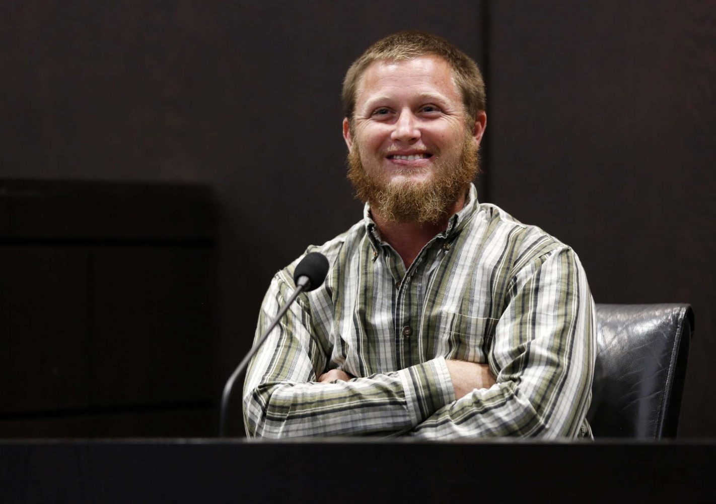 Levy County resident James Raines smiles during a lighthearted moment while testifying during Pedro Bravo's murder trial in courtroom 1B of the Alachua County Criminal Justice Center Friday, August 8, 2014. Raines and brother-in-law Jesse Everidge stumbled upon the remains of Christian Aguilar while the two searched for jasmine vines in the Gulf Hammock Hunt Club.  Bravo is accused of killing University of Florida student Christian Aguilar.  (Doug Finger/The Gainesville Sun/Pool)