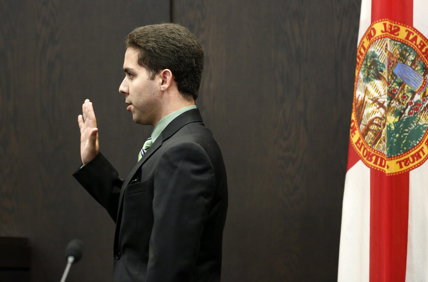 Roberto Finale, one of Pedro Bravo's two roommates, is sworn in during Bravo's murder trial in courtroom 1B of the Alachua County Criminal Justice Center Friday, August 8, 2014.  Bravo is accused of killing University of Florida student Christian Aguilar.  (Doug Finger/The Gainesville Sun/Pool)