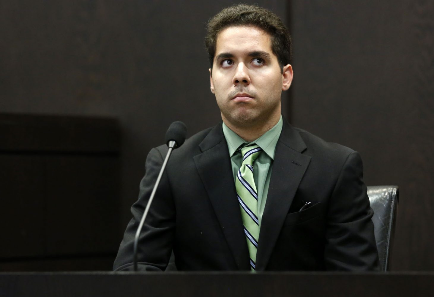Roberto Finale, one of Pedro Bravo's two roommates, testifies during Bravo's murder trial in courtroom 1B of the Alachua County Criminal Justice Center Friday, August 8, 2014.  Bravo is accused of killing University of Florida student Christian Aguilar.  (Doug Finger/The Gainesville Sun/Pool)