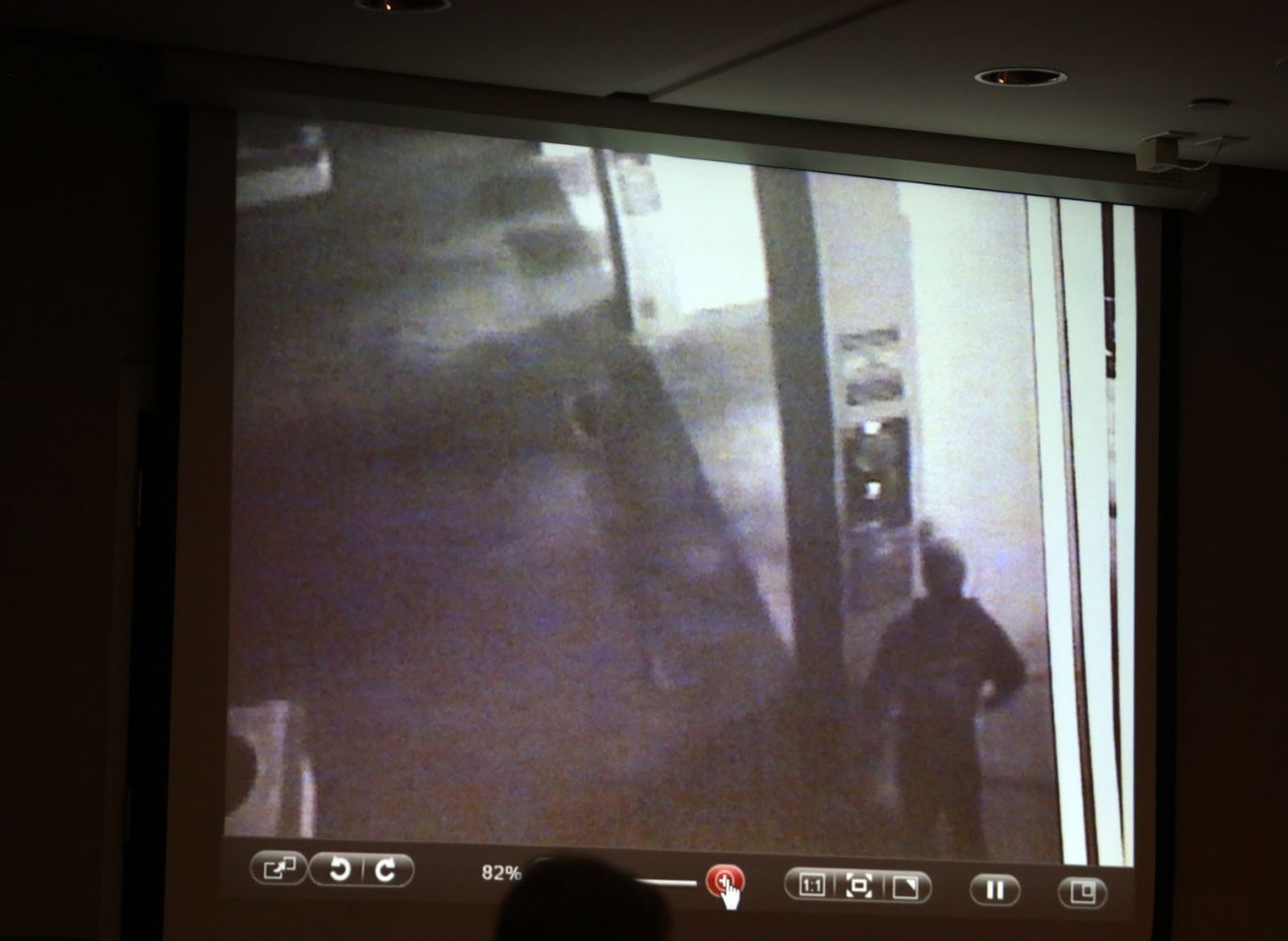 A screen grab from a surveillance camera at Scrubs Car Wash allegedly of Pedro Bravo is shown to the jury during Bravo's murder trial in courtroom 1B of the Alachua County Criminal Justice Center Friday, August 8, 2014.  Bravo is accused of killing University of Florida student Christian Aguilar.  (Doug Finger/The Gainesville Sun/Pool)