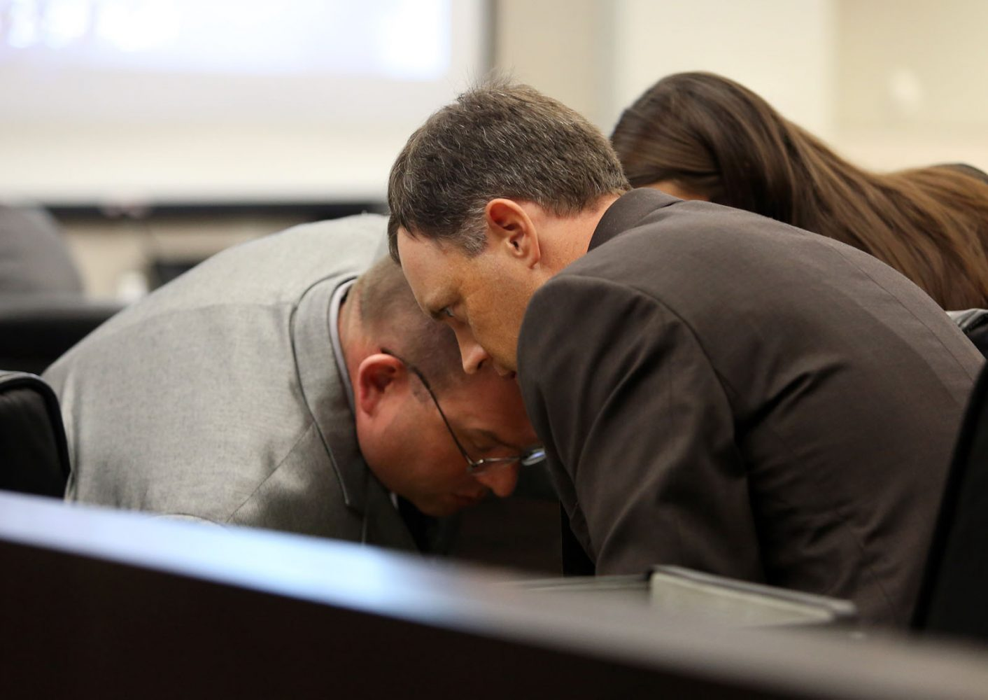 Assistant State Attorney Bill Ezzell huddles with prosecuting attorney Brian Kramer and intern Christine Young during Pedro Bravo's murder trial in courtroom 1B of the Alachua County Criminal Justice Center Friday, August 8, 2014.  Bravo is accused of killing University of Florida student Christian Aguilar.  (Doug Finger/The Gainesville Sun/Pool)