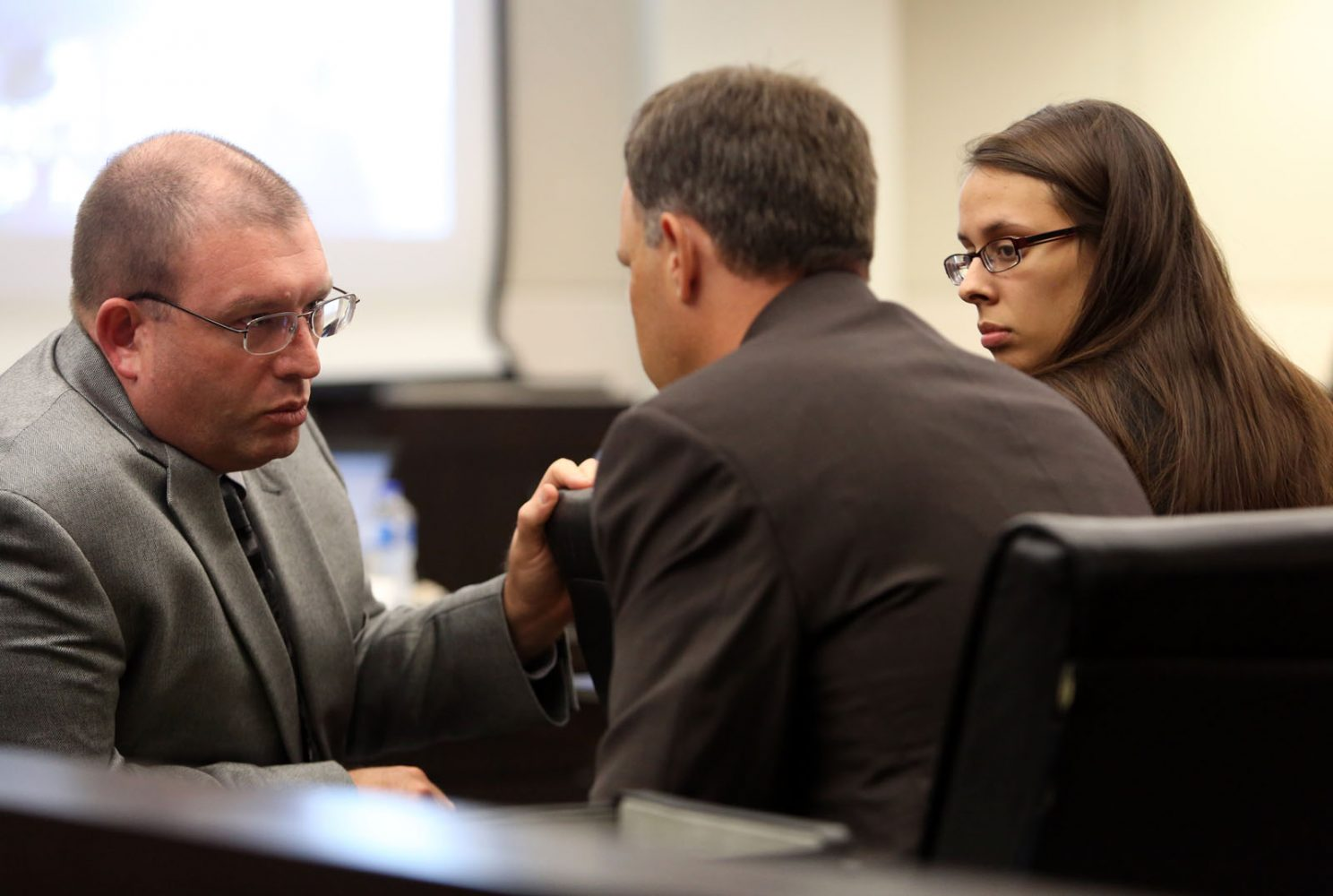 Prosecuting attorney Brian Kramer speaks with assistant state attorney Bill Ezzell and intern Christine Young during Pedro Bravo's murder trial in courtroom 1B of the Alachua County Criminal Justice Center Friday, August 8, 2014.  Bravo is accused of killing University of Florida student Christian Aguilar.  (Doug Finger/The Gainesville Sun/Pool)