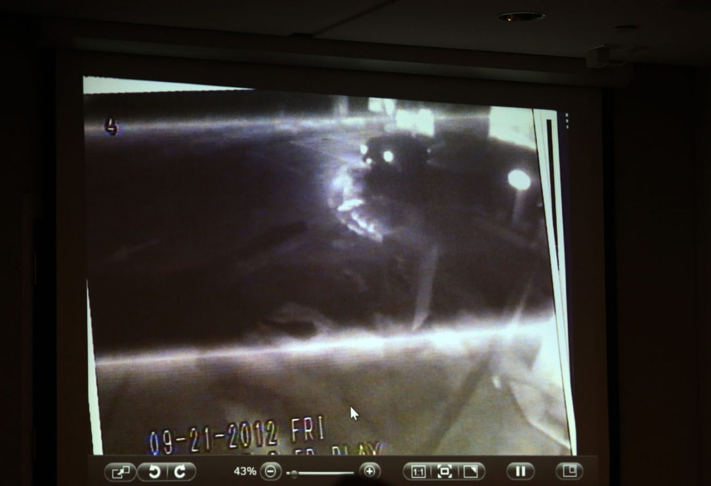 A screen grab from a surveillance camera at Scrubs Car Wash allegedly showing Pedro Bravo's Chevy Blazer leaving the wash is shown to the jury during Bravo's murder trial in courtroom 1B of the Alachua County Criminal Justice Center Friday, August 8, 2014.  Bravo is accused of killing University of Florida student Christian Aguilar.  (Doug Finger/The Gainesville Sun/Pool)
