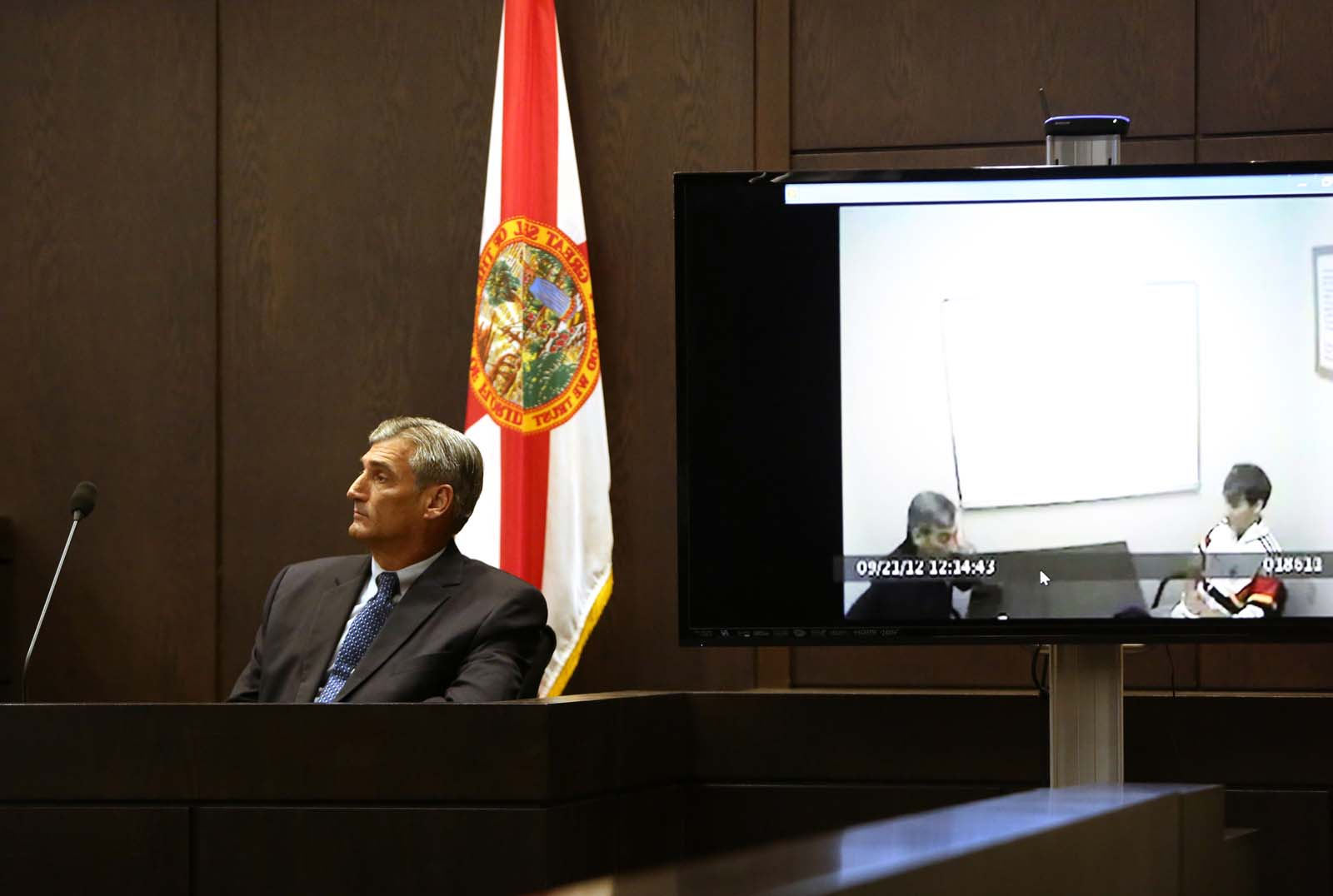 University Police Sgt. Steven Wilder views his September 21, 2012 interview with Pedro Bravo during Bravo's murder trial in courtroom 1B of the Alachua County Criminal Justice Center Monday, August 11, 2014.  Bravo is accused of killing University of Florida student Christian Aguilar.  (Doug Finger/The Gainesville Sun/Pool)