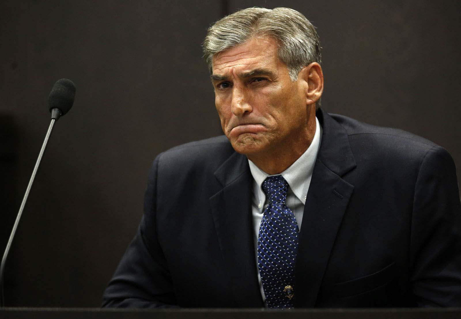 University Police Sgt. Steven Wilder is cross examined by defensive attorney Michael Ruppert during Pedro Bravo's murder trial in courtroom 1B of the Alachua County Criminal Justice Center Monday, August 11, 2014.  Bravo is accused of killing University of Florida student Christian Aguilar.  (Doug Finger/The Gainesville Sun/Pool)