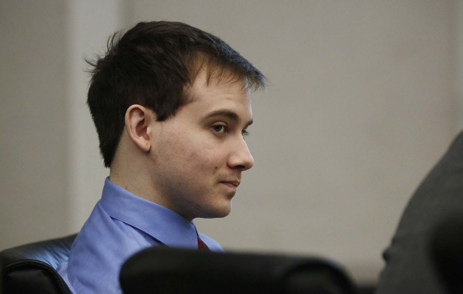 Pedro Bravo smirks while listening to his interview with Gainesville Police Det. Randy Roberts during Bravo's murder trial in courtroom 1B of the Alachua County Criminal Justice Center Monday, August 11, 2014.  Bravo is accused of killing University of Florida student Christian Aguilar.  (Doug Finger/The Gainesville Sun/Pool)