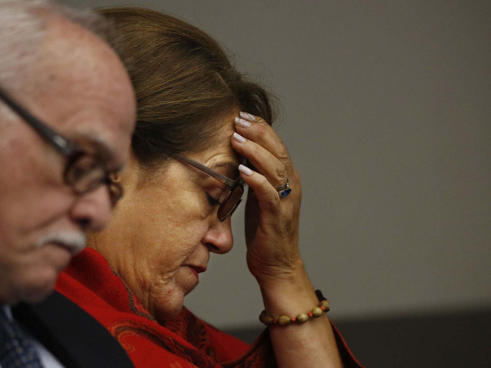 Azucena Duque, the mother of Pedro Bravo, listens to her son's interview with Gainesville Police Det. Randy Roberts during Bravo's murder trial in courtroom 1B of the Alachua County Criminal Justice Center Monday, August 11, 2014.  Bravo is accused of killing University of Florida student Christian Aguilar.  (Doug Finger/The Gainesville Sun/Pool)