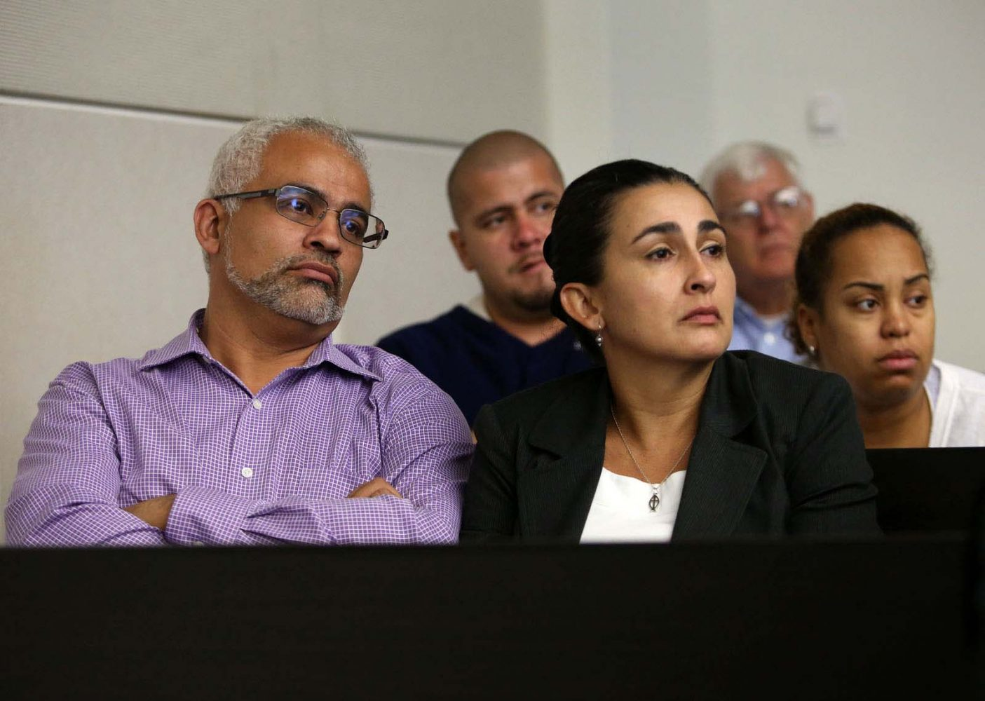 Carlos and Claudia Aguilar, the parents of slain University of Florida student Christian Aguilar, listen to an interview between Pedro Bravo and Gainesville Police Det. Randy Roberts during Bravo's murder trial in courtroom 1B of the Alachua County Criminal Justice Center Monday, August 11, 2014.  Bravo is accused of killing University of Florida student Christian Aguilar.  (Doug Finger/The Gainesville Sun/Pool)