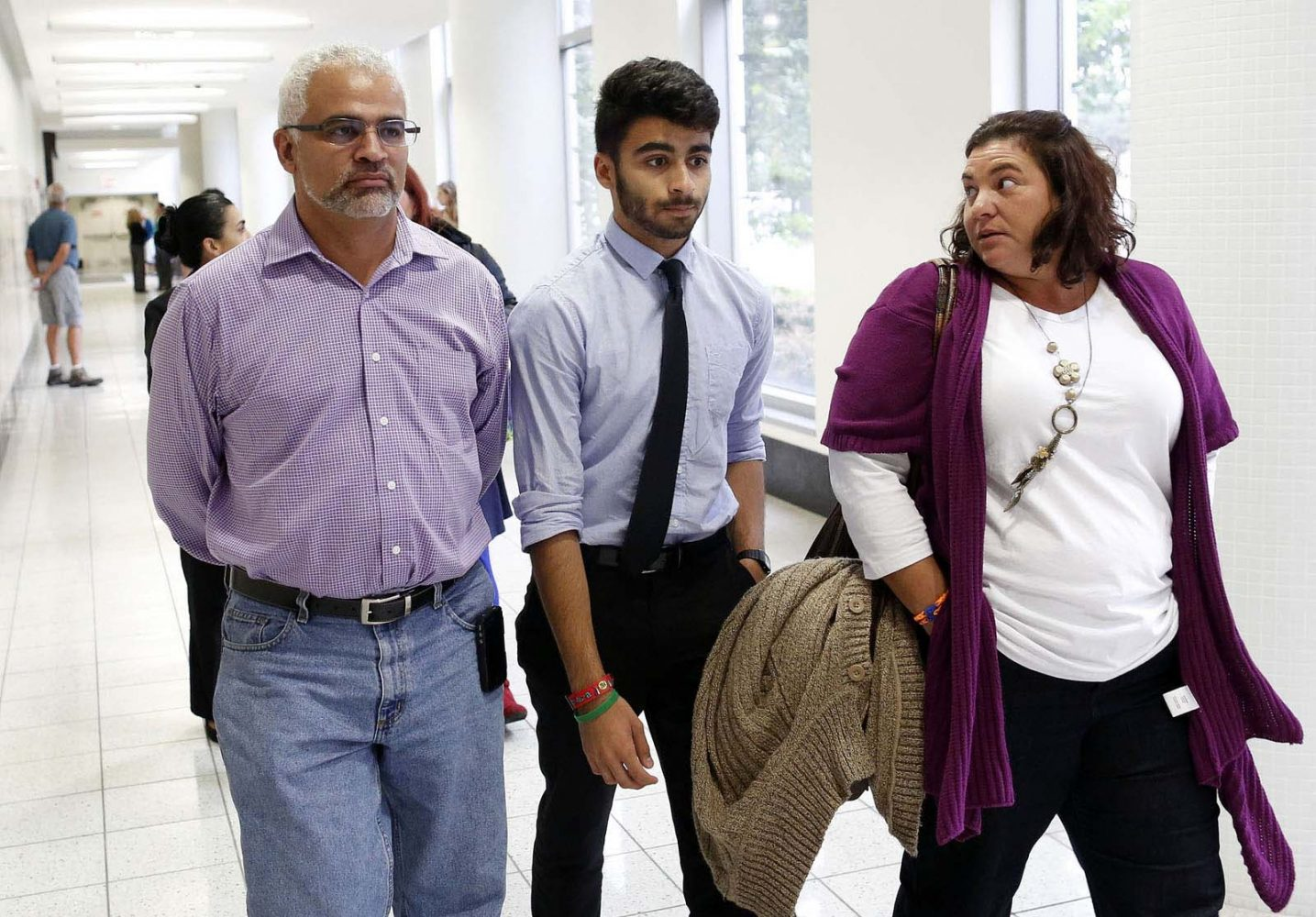 Carlos and Alex Aguilar, the father and brother of slain University of Florida student Christian Aguilar, walk the hall of the Alachua County Criminal Justice Center during a mid-afternoon break in the murder trial of Pedro Bravo Monday, August 11, 2014.  Bravo is accused of killing University of Florida student Christian Aguilar.  (Doug Finger/The Gainesville Sun/Pool)
