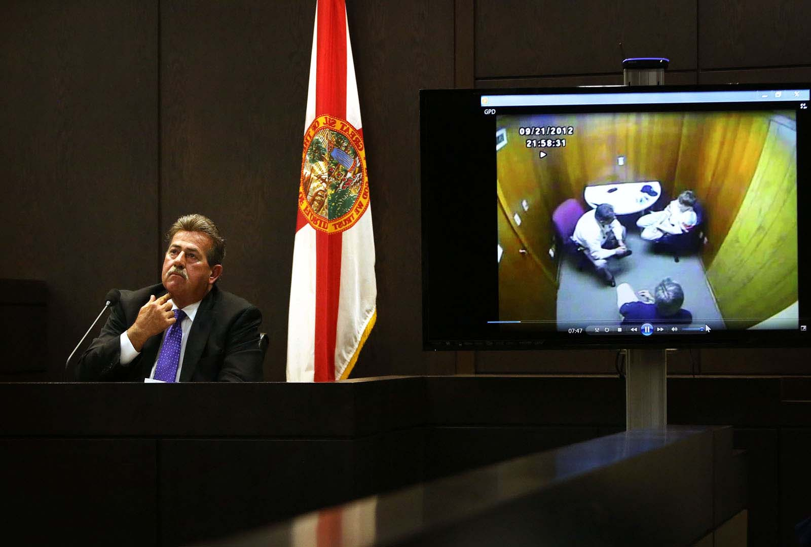Gainesville Police Det. Randy Roberts listens to his interview with Pedro Bravo as it's played for the jury during Pedro Bravo's murder trial in courtroom 1B of the Alachua County Criminal Justice Center Monday, August 11, 2014.  Bravo is accused of killing University of Florida student Christian Aguilar.  (Doug Finger/The Gainesville Sun/Pool)