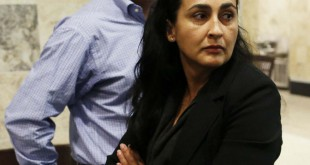 Claudia Aguilar walks away after telling her husband Carlos, at back, about the what she saw during autopsy testimony of their son Christian during a brief recess in the Pedro Bravo murder trial at the Alachua County Criminal Justice Center Tuesday, August 12, 2014.  Carlos wasn't in the courtroom during this period.  Bravo is accused of killing University of Florida student Christian Aguilar.  (Doug Finger/The Gainesville Sun/Pool)