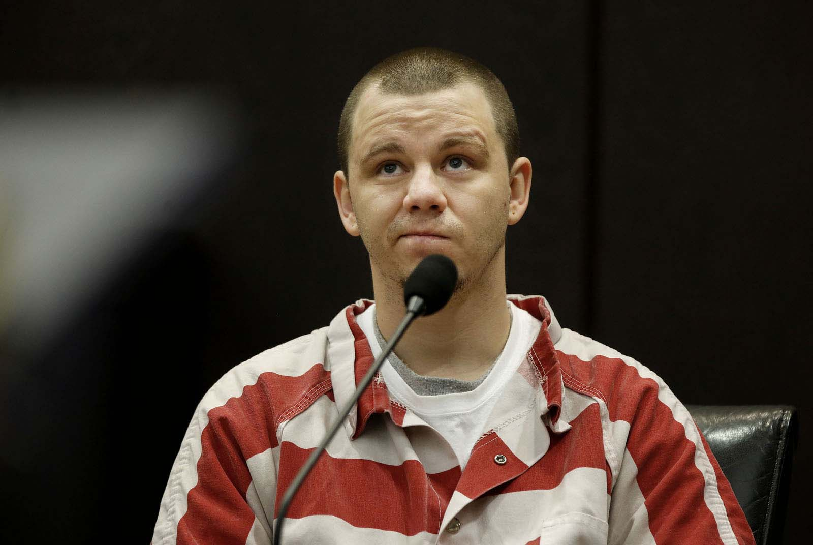 Levy County inmate Michael Angelo testifies during Pedro Bravo's murder trial in courtroom 1B of the Alachua County Criminal Justice Center Wednesday, August 13, 2014. Angelo was Bravo's cellmate at the Alachua County Jail. Bravo is accused of killing University of Florida student Christian Aguilar.  (Doug Finger/The Gainesville Sun/Pool)